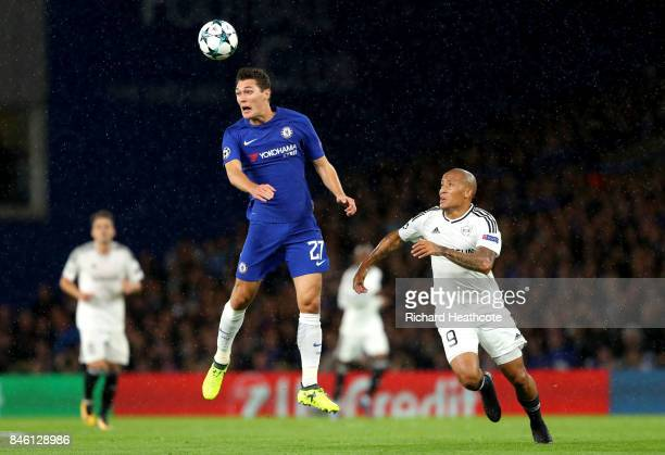Andreas Christensen of Chelsea heads the ball while under pressure from Dino Ndlovu of Qarabag FK during the UEFA Champions League Group C match...