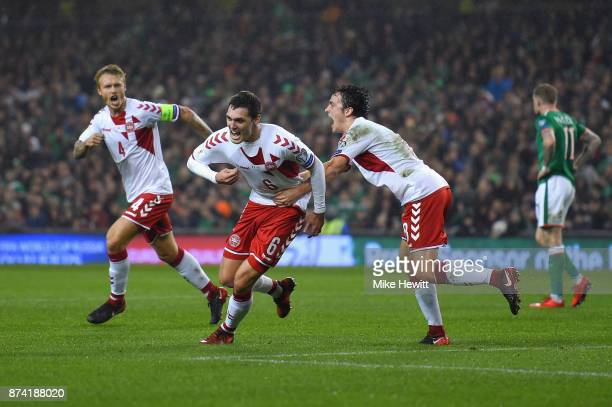 Andreas Christensen of Denmakr celebrates his sides first goal as Cyrus Christie of the Republic of Ireland scores a own goal during the FIFA 2018...