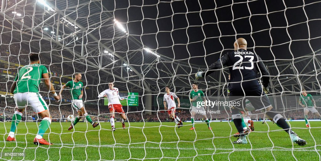 Andreas Christensen of Denmakr (L) shoots and his shot is deflected in by Cyrus Christie of the Republic of Ireland (L) for a own goal and Denmark's first goal of the game during the FIFA 2018 World Cup Qualifier Play-Off: Second Leg between Republic of Ireland and Denmark at Aviva Stadium on November 14, 2017 in Dublin, Ireland.