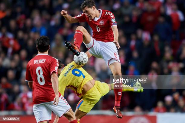 Andreas Christensen of Denmark and Florin Andone of Romania compete for the ball during the FIFA World Cup 2018 qualifier match between Denmark and...