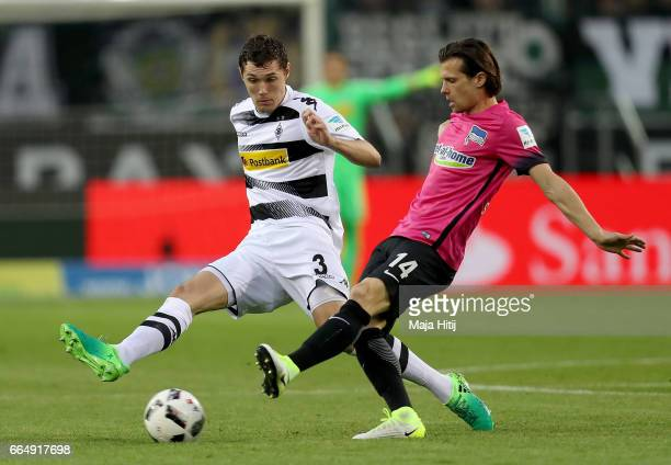Andreas Christensen of Gladbach and Valentin Stocker of Berlin battle for the ball during the Bundesliga match between Borussia Moenchengladbach and...