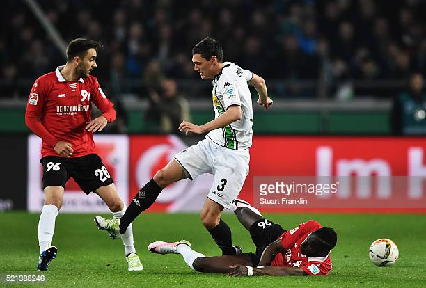 Andreas Christensen of Gladbach is challenged by Salif Sané of Hannover during the Bundesliga match between Hannover 96 and Borussia Moenchengladbach...