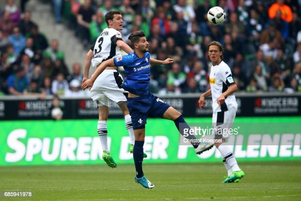 Andreas Christensen of Moenchengladbach and Antonio Colak of Darmstadt go up for a header during the Bundesliga match between Borussia...