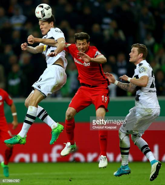 Andreas Christensen of Moenchengladbach and David Abraham of Frankfurt battle for the ball during the DFB Cup semi final match between Borussia...