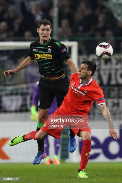 Andreas Christensen of Moenchengladbach and Nikola Kalinic of Fiorentina battle for the ball during the UEFA Europa League Round of 32 first leg...