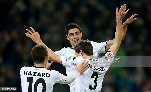 Andreas Christensen of Moenchengladbach celebrates with team mates Thorgan Hazard of Moenchengladbach and Lars Stindl of Moenchengladbach after...