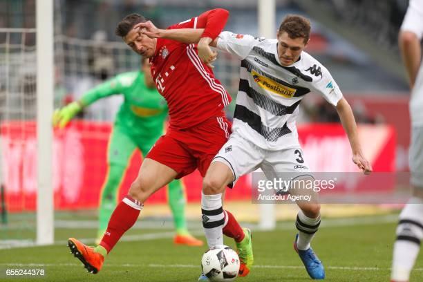 Andreas Christensen of Moenchengladbach in action against Robert Lewandowski of Bayern Munich during the Bundesliga Match between Borussia...
