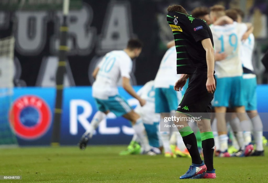 Andreas Christensen (front) of Moenchengladbach reacts as players of Schalke celebrate after the UEFA Europa League Round of 16 second leg match between Borussia Moenchengladbach and FC Schalke 04 at Borussia Park Stadium on March 16, 2017 in Moenchengladbach, Germany.