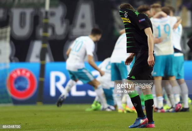 Andreas Christensen of Moenchengladbach reacts as players of Schalke celebrate after the UEFA Europa League Round of 16 second leg match between...