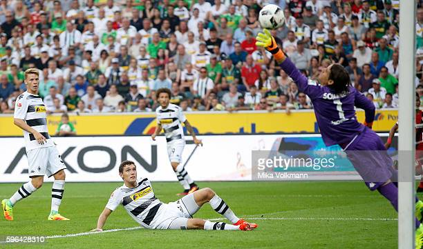 Andreas Christensen of Moenchengladbach shots on his own goal during the Bundesliga match between Borussia Moenchengladbach and Bayer 04 Leverkusen...