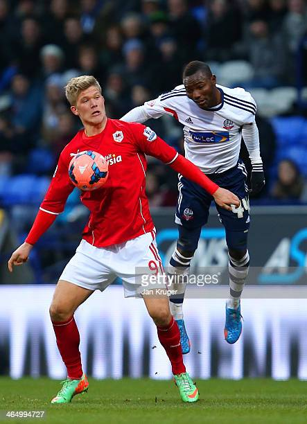 Andreas Cornelius of Cardiff City and Mohamed Kamara of Botlon compete for the ball during the FA Cup Fourth Round match between Bolton Wanderers and...