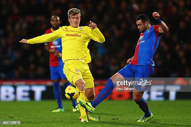 Andreas Cornelius of Cardiff City is tackled by Damien Delaney of Crystal Palace during the Barclays Premier League match between Crystal Palace and...