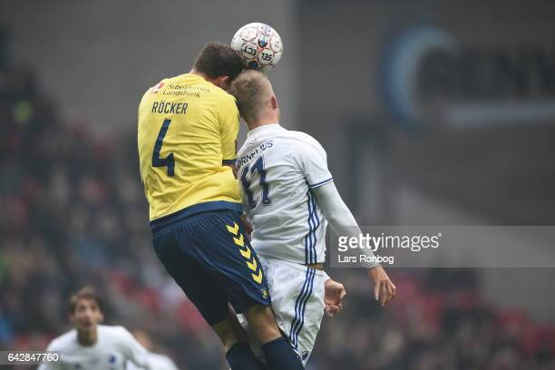 Andreas Cornelius of FC Copenhagen and Benedikt Rocker of Brondby IF compete for the ball during the Danish Alka Superliga match between FC...