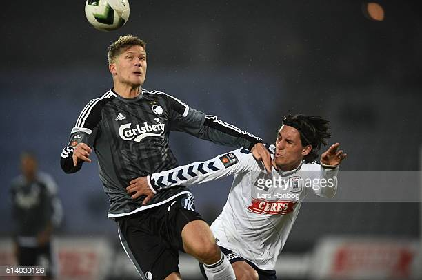 Andreas Cornelius of FC Copenhagen and Daniel A Pedersen of AGF Aarhus compete for the ball during the Danish Alka Superliga match between AGF Aarhus...