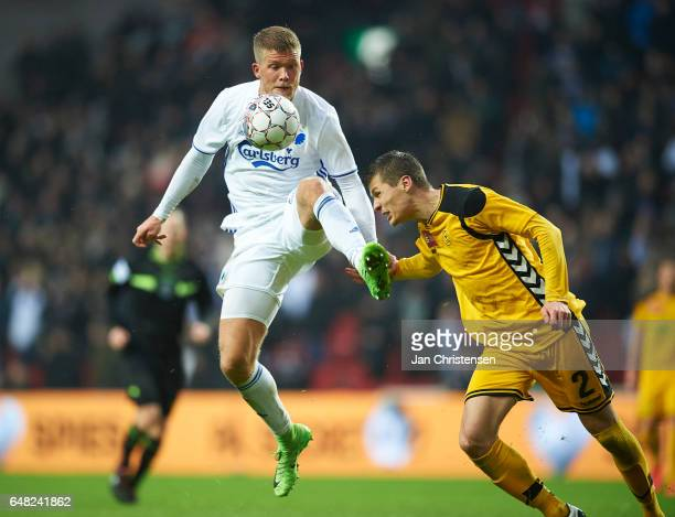 Andreas Cornelius of FC Copenhagen and Elfar Freyr Helgason of AC Horsens compete for the ball during the Danish Alka Superliga match between FC...