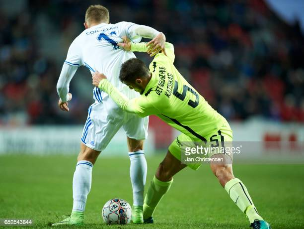 Andreas Cornelius of FC Copenhagen and Giorgos Katsikas of Esbjerg fB compete for the ball during the Danish Alka Superliga match between FC...