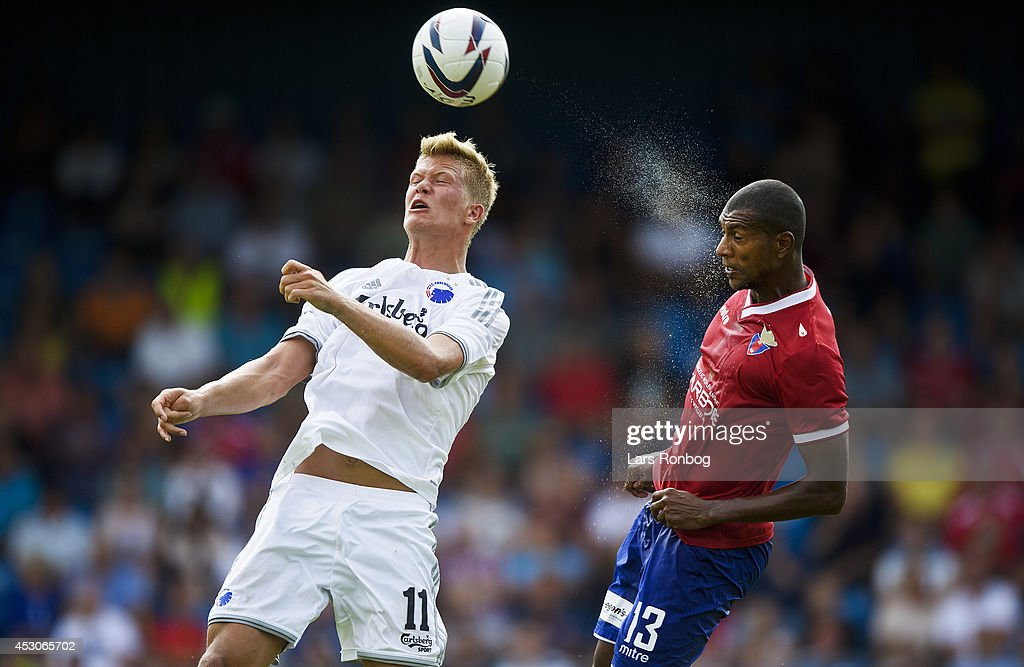 <a gi-track='captionPersonalityLinkClicked' href=/galleries/search?phrase=Andreas+Cornelius&family=editorial&specificpeople=8617821 ng-click='$event.stopPropagation()'>Andreas Cornelius</a> of FC Copenhagen and Jean-Claude Adrimer Bozga of FC Vestsjalland compete for the ball during the Danish Superliga match between FC Vestsjalland and FC Copenhagen at Harboe Arena Slagelse on August 2, 2014 in Slagelse, Denmark.
