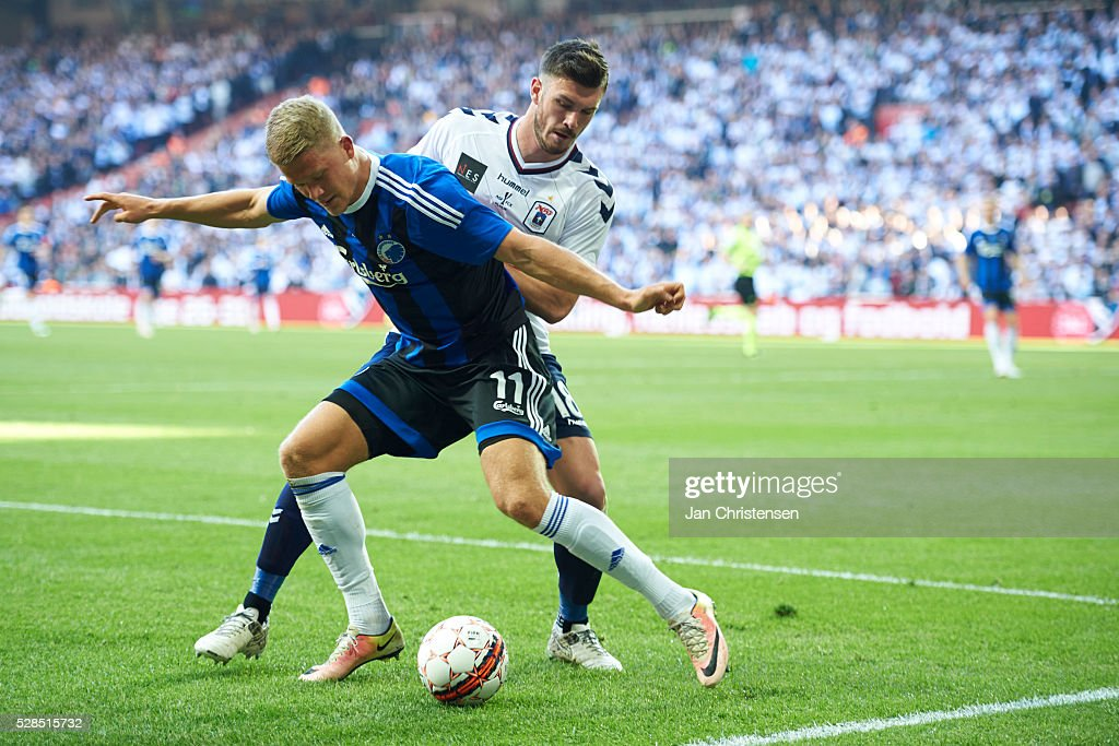 Andreas Cornelius of FC Copenhagen and Josip Elez of AGF Arhus compete for the ball during the DBU Pokalen Cup Final match between AGF Arhus and FC Copenhagen at Telia Parken Stadium on May 05, 2016 in Copenhagen, Denmark.
