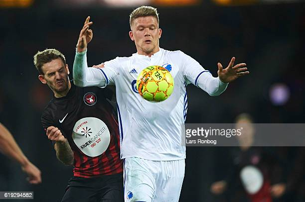 Andreas Cornelius of FC Copenhagen and Kian Hansen of FC Midtjylland compete for the ball during the Danish Alka Superliga match between FC...