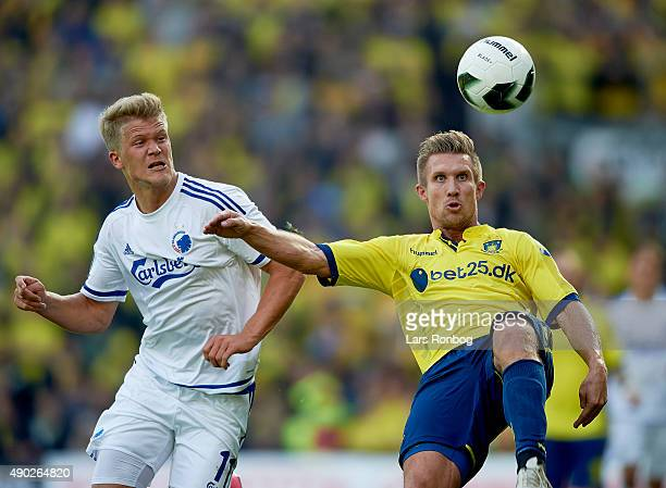 Andreas Cornelius of FC Copenhagen and Martin Albrechtsen of Brondby IF compete for the ball during the Danish Alka Superliga match between Brondby...