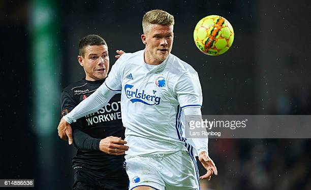 Andreas Cornelius of FC Copenhagen and Mikkel Cramer of Silkeborg IF compete for the ball during the Danish Alka Superliga match between FC...