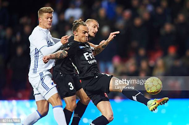 Andreas Cornelius of FC Copenhagen and Pierre Kanstrup of Sonderjyske compete for the ball during the Danish Alka Superliga match between FC...