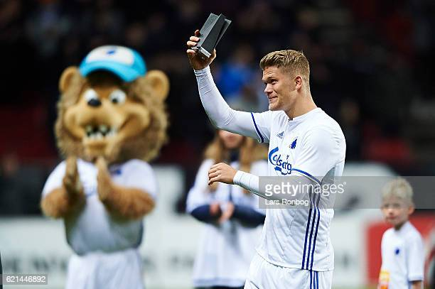 Andreas Cornelius of FC Copenhagen receives the October Month of the Player trophy prior to the Danish Alka Superliga match between FC Copenhagen and...
