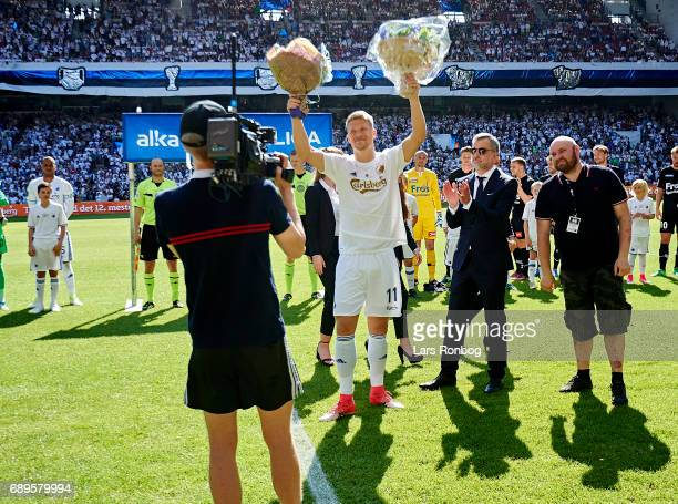 Andreas Cornelius of FC Copenhagen receiving flowers before his last match for the club prior to the Danish Alka Superliga match between FC...