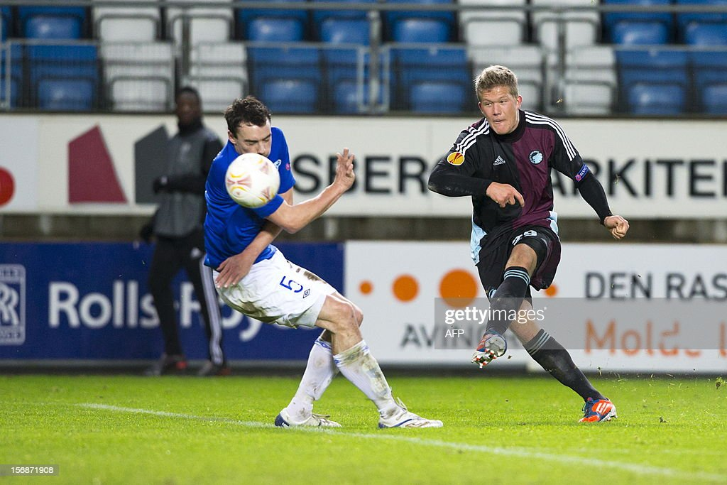 Andreas Cornelius (R) of FC Copenhagen shoots past Vegard Forren of Molde FK during the UEFA Europa League Group E football match Molde FK vs FC Kobenhavn in Molde, Norway on November 22, 2012. AFP PHOTO / SCANPIX SWEDEN / SVEIN OVE EKORNESVAAG SWEDEN OUT