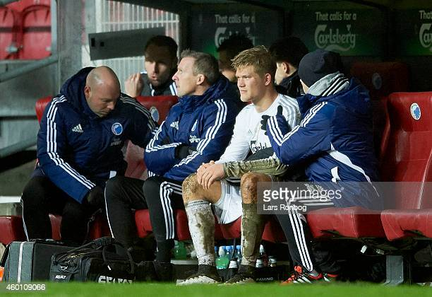 Andreas Cornelius of FC Copenhagen sits on the bench and being helped with a neck injury by the physioterapeut during the Danish Superliga match...