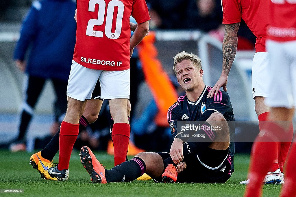 <a gi-track='captionPersonalityLinkClicked' href=/galleries/search?phrase=Andreas+Cornelius&family=editorial&specificpeople=8617821 ng-click='$event.stopPropagation()'>Andreas Cornelius</a> of FC Copenhagen sitting on the pitch injured on his left food during the Danish Alka Superliga match between Silkeborg IF and FC Copenhagen at Mascot Park on April 13, 2015 in Silkeborg, Denmark.