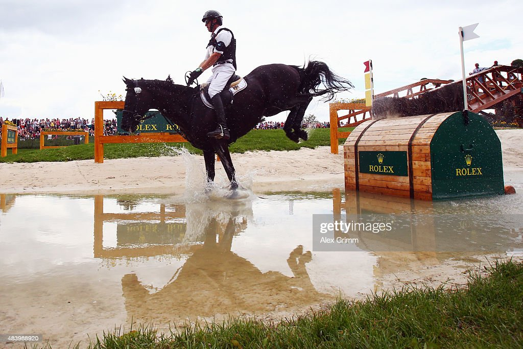 Andreas Dibowski of Germany competes on his horse FRH Butts Avedon during the Eventing Cross Country test on Day 3 of the FEI European Equestrian...
