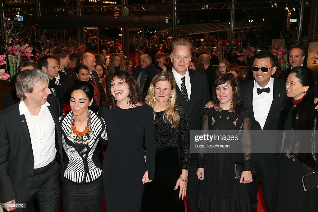 Andreas Dresen, Shirin Neshat, Susanne Bier, Ellen Kuras,Tim Robbins, Athina Rachel Tsangari Jury President Wong Kar Wai and his wife Esther Wong attend 'The Grandmaster' Premiere during the 63rd Berlinale International Film Festival at Berlinale Palast on February 7, 2013 in Berlin, Germany.