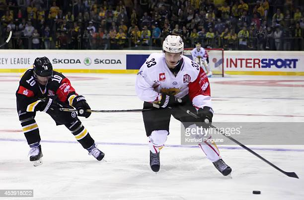 Andreas Driendl competes against Anton Karlsson during the Champions Hockey League group stage game between Krefeld Pinguine and Skelleftea AIK on...