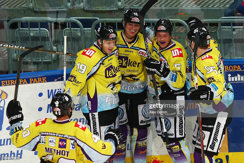 Andreas Driendl of Krefeld celebrates his team's third goal with team mates during the DEL match between Adler Mannheim and Krefeld Pinguine at SAP-Arena on October 12, 2012 in Mannheim, Germany.