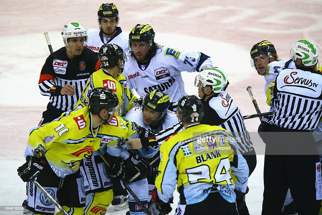 Andreas Driendl of Krefeld Pinguine (L) and <a gi-track='captionPersonalityLinkClicked' href=/galleries/search?phrase=Ian+Gordon&family=editorial&specificpeople=836193 ng-click='$event.stopPropagation()'>Ian Gordon</a> of ERC Ingolstadt fight during the fifth DEL Play-Off-match between Krefeld Pinguine and ERC Ingolstadt at Koenigspalast on March 28, 2013 in Wuppertal, Germany.