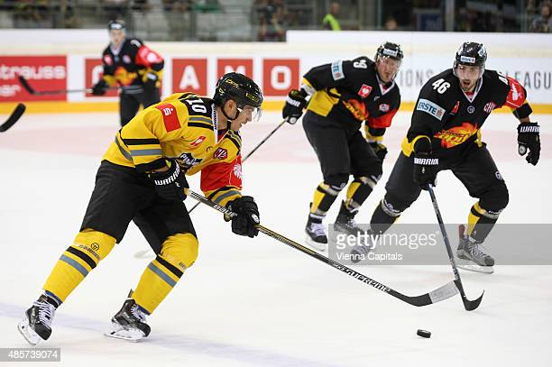 Andreas Driendl of Krefeld Pinguine and Matthew Dzieduszycki of EV Vienna Capitals during the Champions Hockey League group stage game between Vienna...