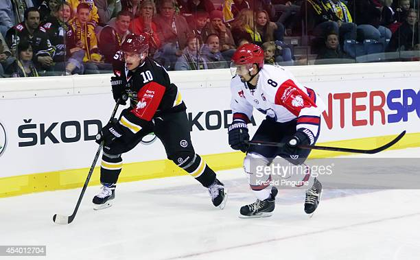 Andreas Driendl vs Daniel Grillfors during the Champions Hockey League group stage game between Krefeld Pinguine and IFK Helsinki on August 23 2014...
