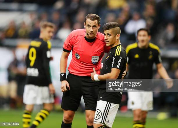 Andreas Ekberg referee and Nicolas Stefanelli of AIK in discussion during the Allsvenskan match between AIK and Jonkopings Sodra IF at Friends Arena...