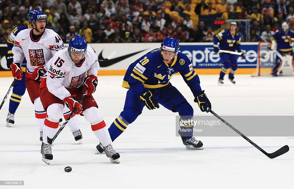 Andreas Engqvist (R) of Sweden and Jan Marek (L) of Czech Republic battle for the puck during the IIHF World Championship semifinal match between Sweden and Czech Republic at Lanxess Arena on May 22, 2010 in Cologne, Germany.
