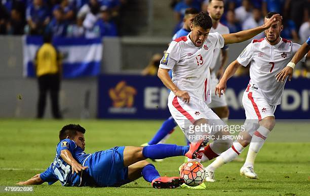 Andreas Flores of El Salvador vies for the ball with Jonathan Osorio of Canada during their 2015 Concacaf Gold Cup match in Carson California on July...