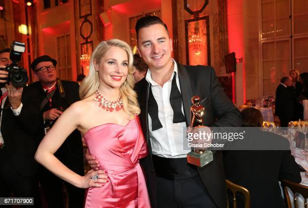 Andreas Gabalier and his girlfriend Silvia Schneider with award during the ROMY award at Hofburg Vienna on April 22 2017 in Vienna Austria