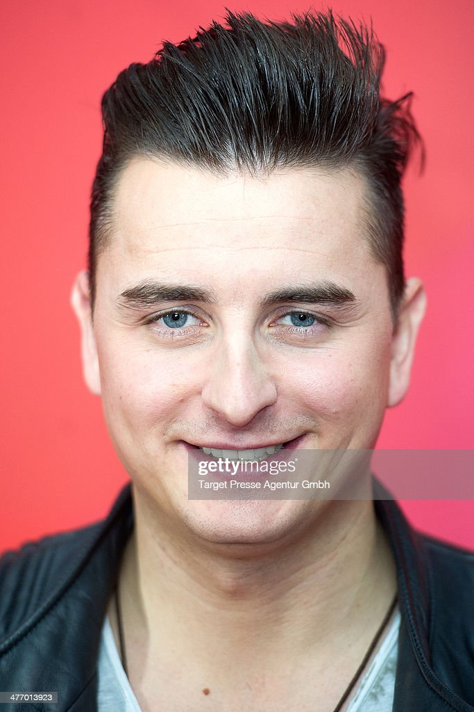 Andreas Gabalier attends the 'Sing meinen Song - das Tauschkonzert' photocall at Asphalt Club on March 6, 2014 in Berlin, Germany.