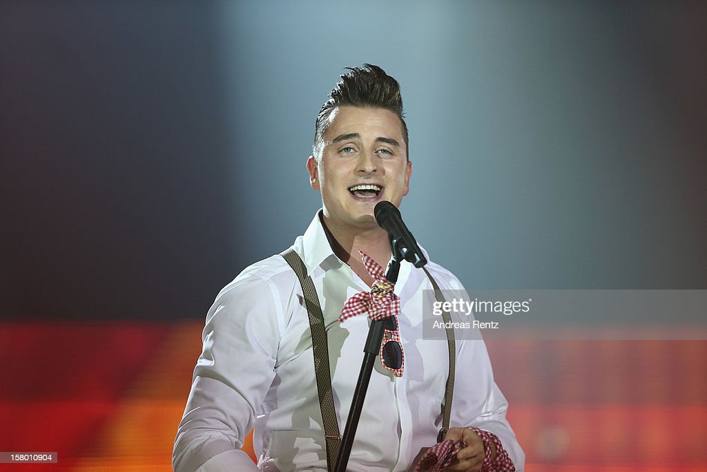 Andreas Gabalier performs on stage during the Andrea Berg 'Die 20 Jahre Show' at Baden Arena on December 7, 2012 in Offenburg, Germany.