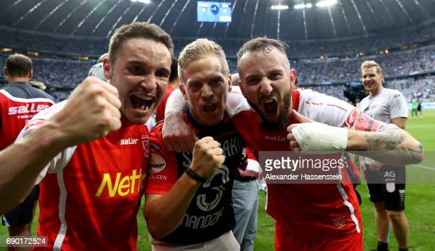 Andreas Geipl of Jahn Regensburg and Marvin Knoll celebrate after the Second Bundesliga Playoff second leg match betweenTSV 1860 Muenchen and Jahn...