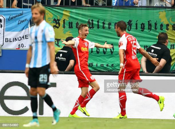 Andreas Geipl of Jahn Regensburg celebrate with team mates Marco Guettner after he scores the 2nd goal during the Second Bundesliga Playoff second...