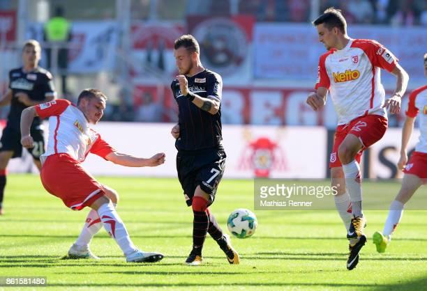Andreas Geipl of SSV Jahn Regensburg Marcel Hartel of 1 FC Union Berlin and Sebastian Stolze of SSV Jahn Regensburg during the Second Bundesliga...