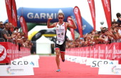 Andreas Giglmayr of Austria crosses the line in second place during the Challenge Triathlon Rimini on May 11 2014 in Rimini Italy