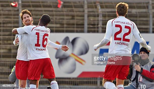 Andreas Glockner Kusi Kwame and Florian Hoernig of Koeln celebrate their teams first goal during the Third League match between between Fortuna Koeln...