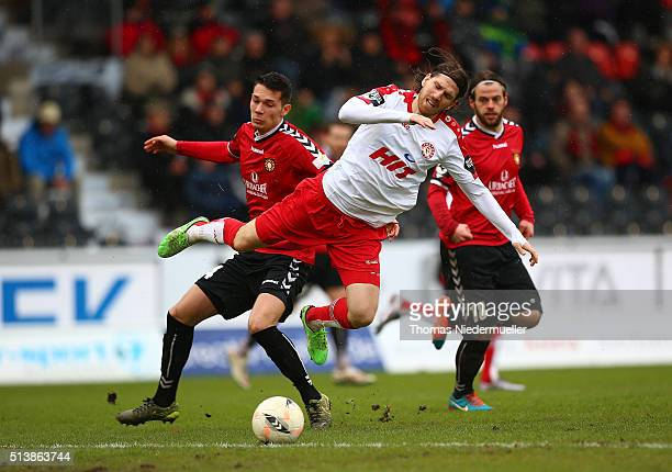 Andreas Glockner of Fortuna Koeln in action with Jeremias Lorch of Grossaspach during the third league match between SG Sonnenhof Grossaspach and...